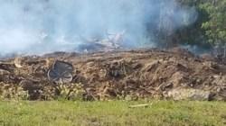 Plastic lids on burn pile, 30.7658333, -83.5536111