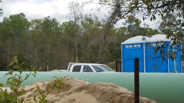 White truck over berm and pipe