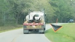 Troy pipe truck, obscured consruction sign, black truck, Knights Ferry Road, 30.7463889, -83.4075000
