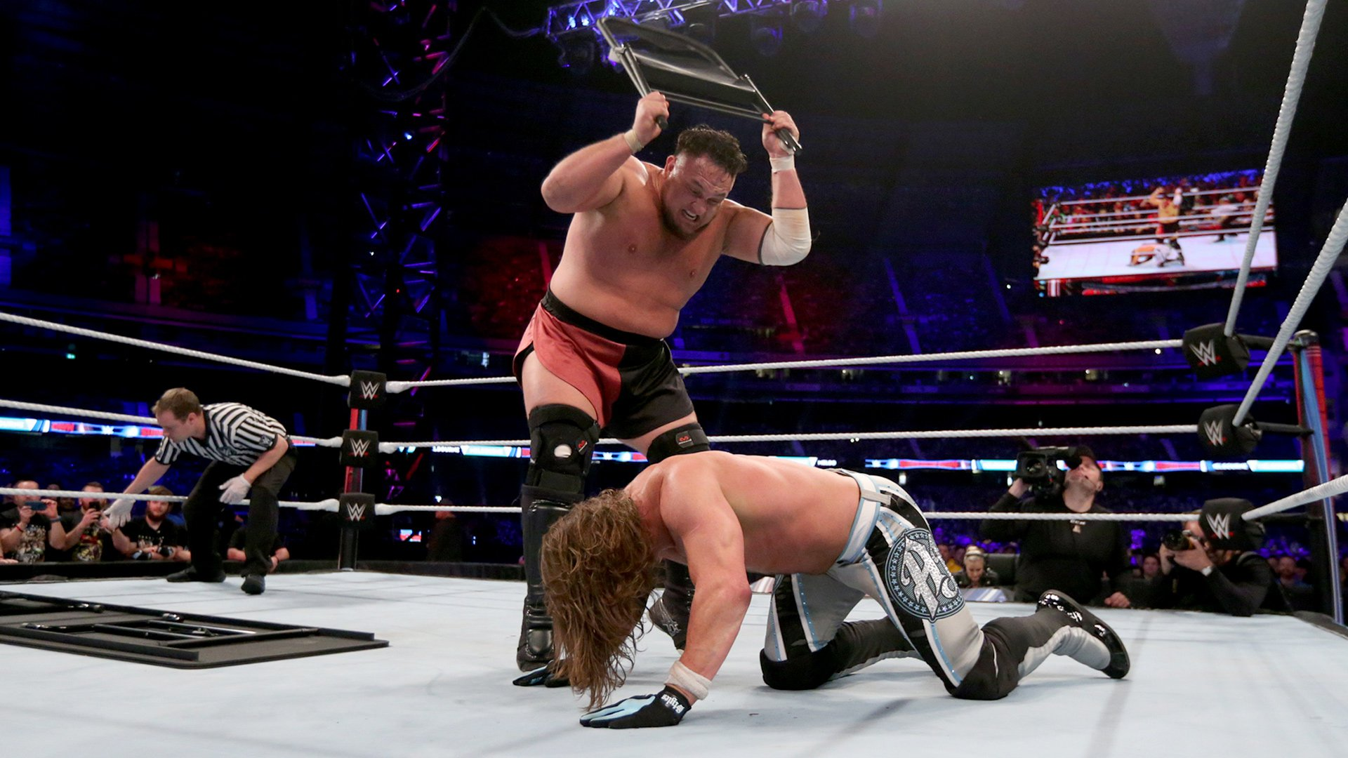steel chair in wrestling gaming with monitors samoa joe smashes aj styles through a wwe super show down 2018 network exclusive