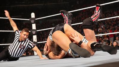The distraction of Styles at ringside allows Ryder to pull off a victory.
