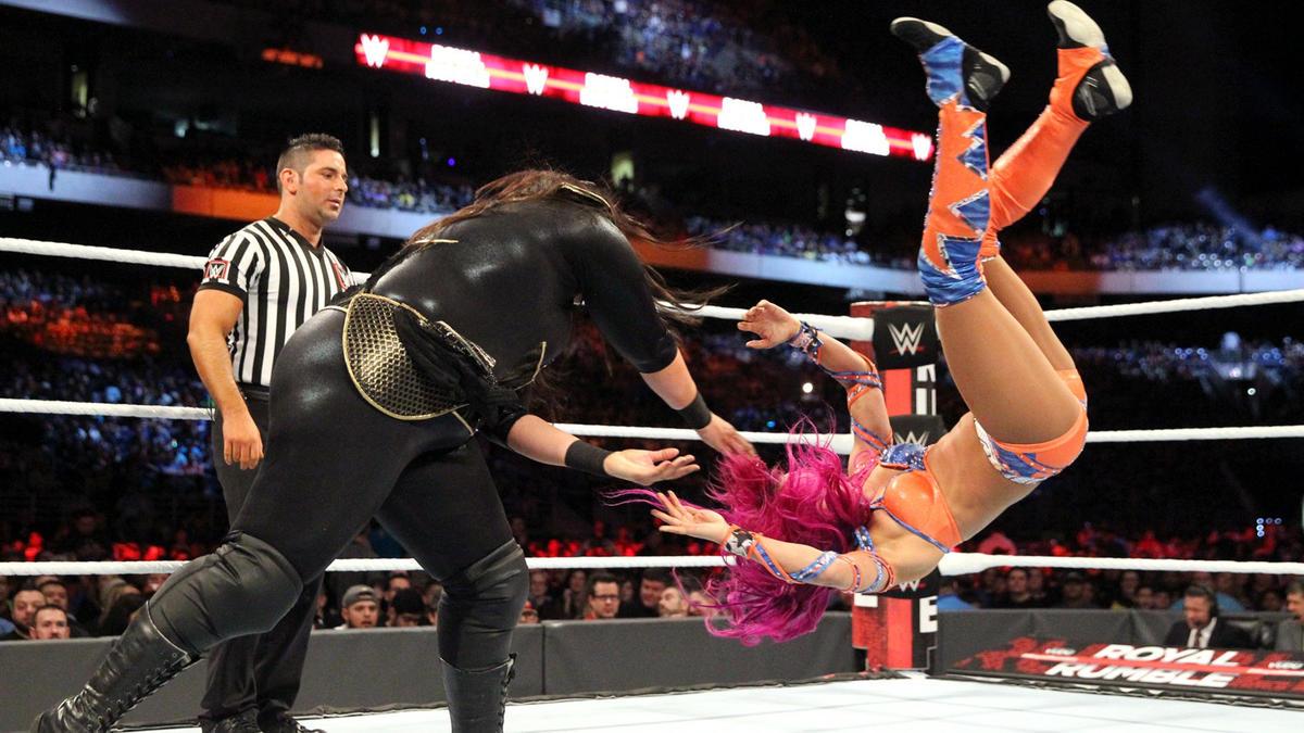 Jax tosses The Legit Boss across the ring like a ragdoll.