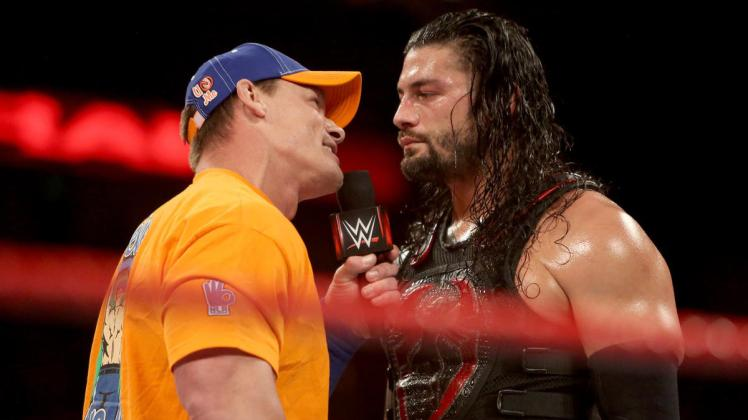 John Cena and Roman Reigns destroyed each other on the microphone on Raw last night