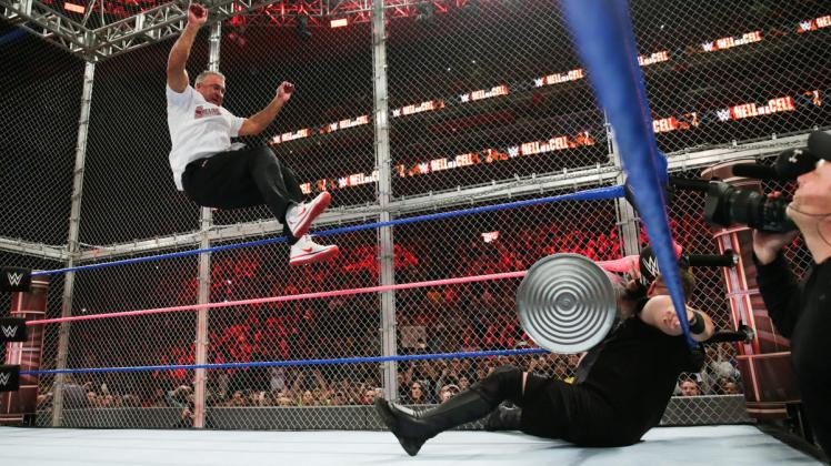 Watch the moment Shane McMahon jumped off the top of Hell in a Cell against Kevin Owens