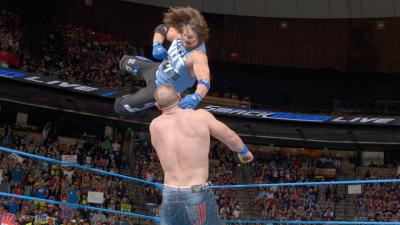 It isn't long before Styles gets into the ring with a Flying Forearm.