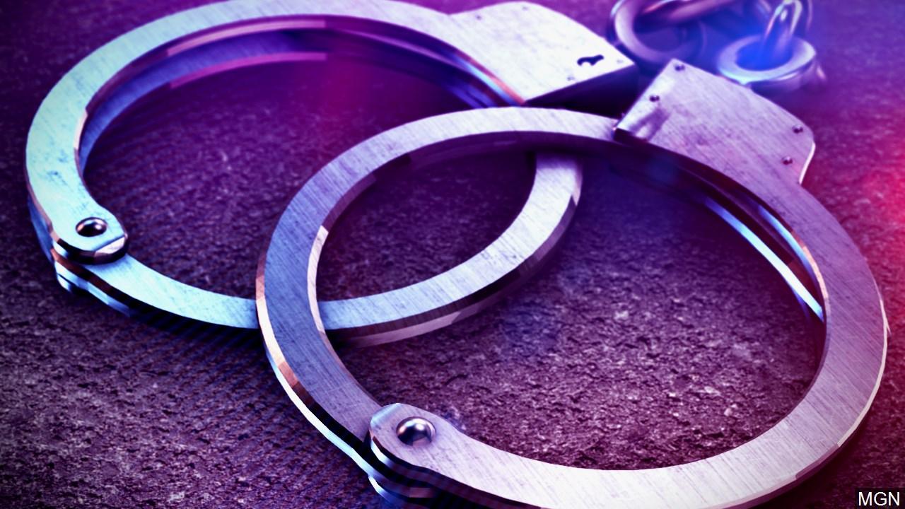 police lights and handcuffs_1532877223438.jpg.jpg