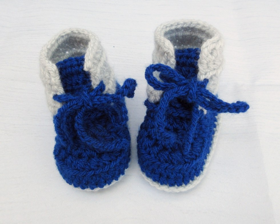 Crochet baby booties with laces