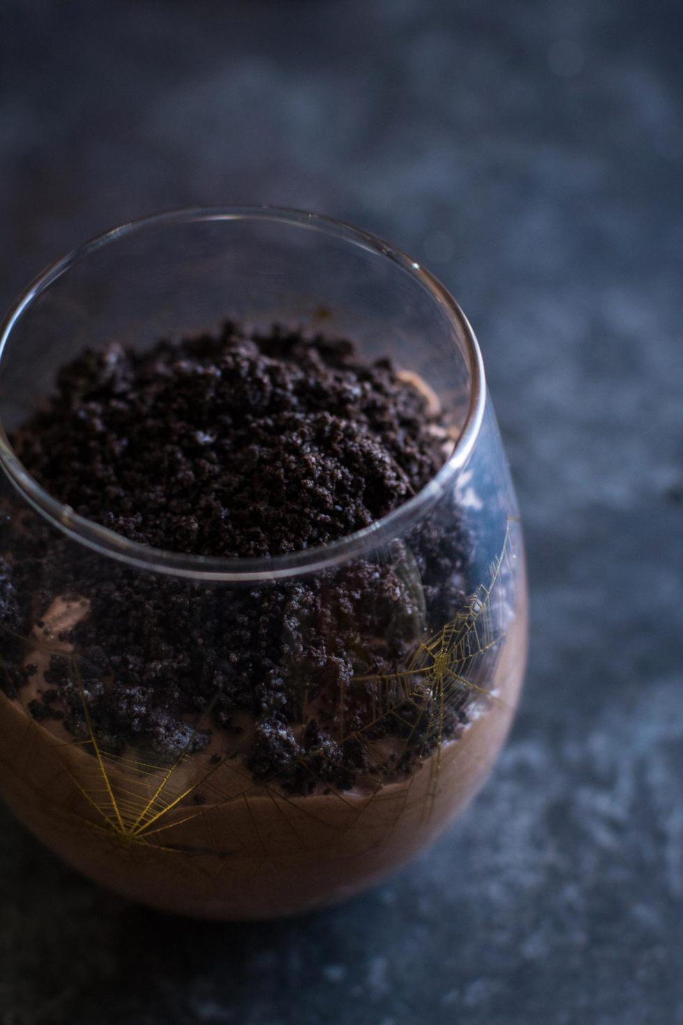 Closeup of oreo cookie topping on top of graveyard chocolate mousse