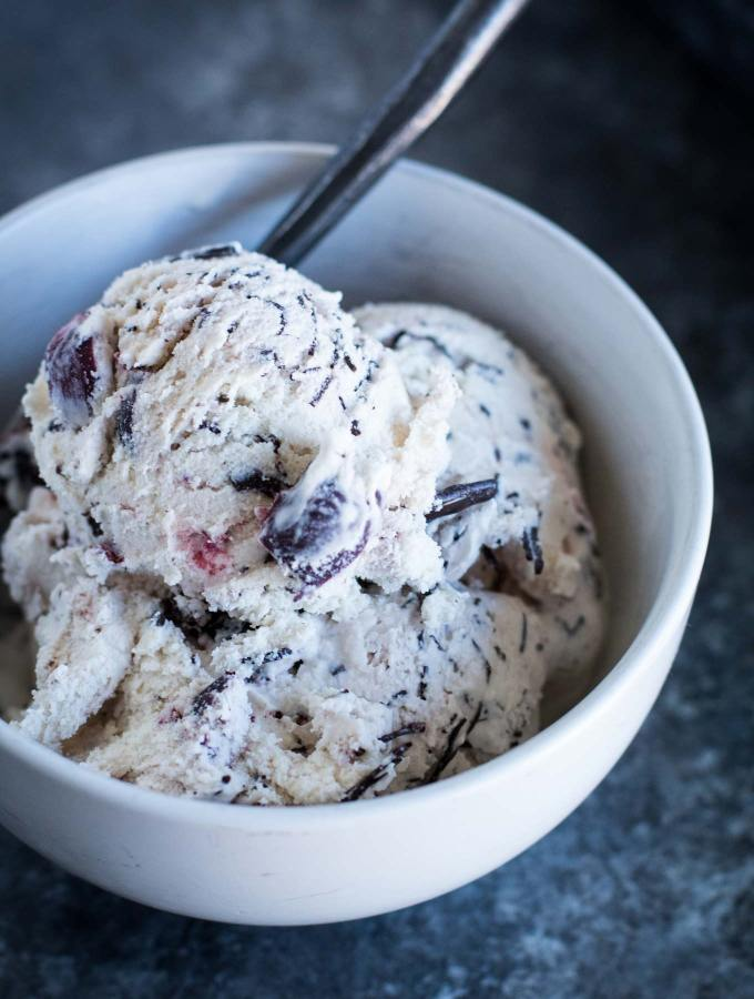 Homemade cherry garcia ice cream without refined sugar! Sweetened with maple syrup and loaded with chunks of cherries and dark chocolate swirls.