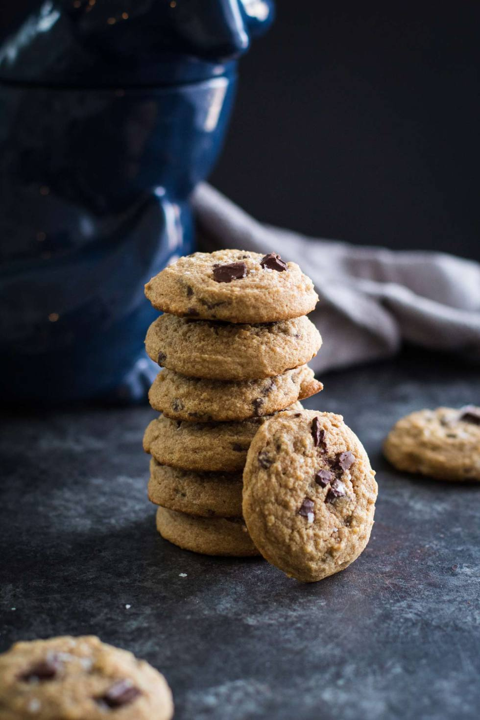 Stack of healthy whole wheat chocolate chip cookies with a cookie balanced against the stack.