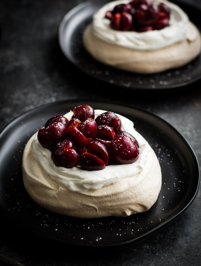 Easy pavlova - a crunchy meringue with a soft marshmallowy inside! Top it with bourbon-soaked cherries for a showstopper dessert!