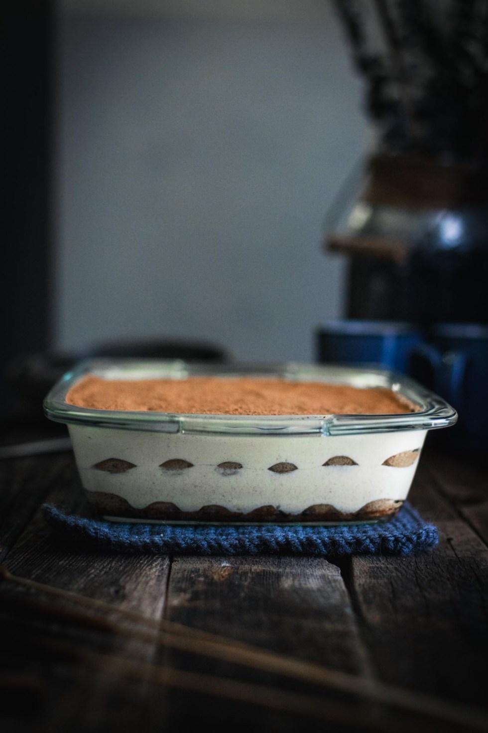 Chai tiramisu in an 8x8-inch glass baking dish on a wooden table