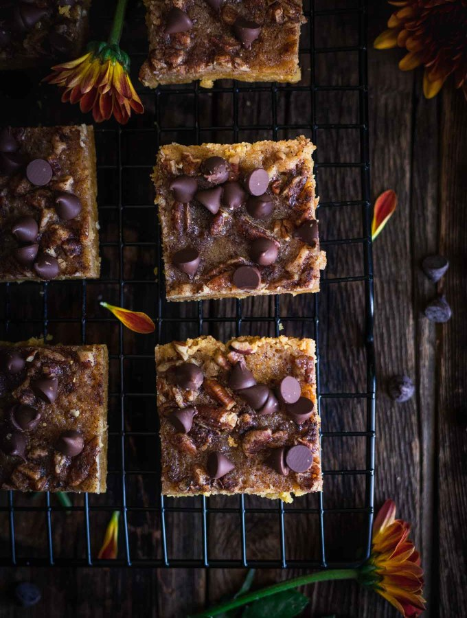 Pumpkin Pecan Toffee Bars cooling on a black cooling rack
