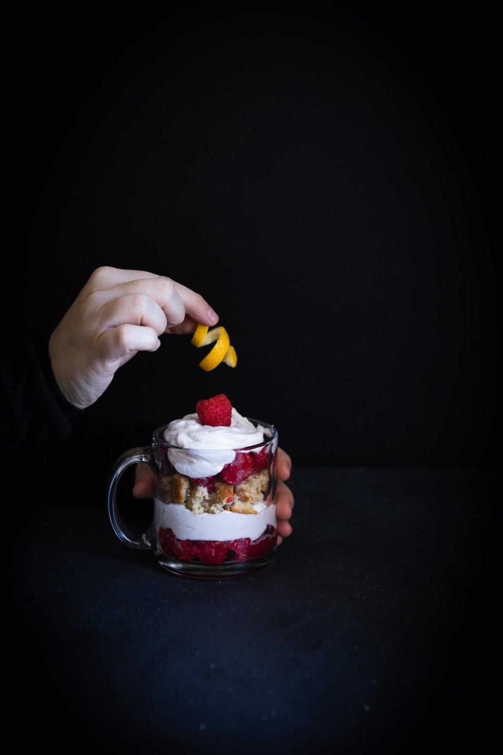 Garnishing a Raspberry Lemon Cake Trifle with a Lemon Peel Twist