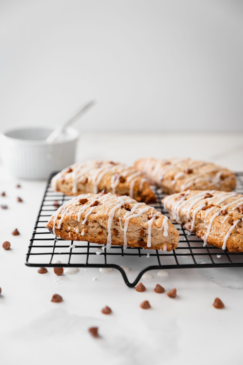 Side view of cinnamon chip scones cooling on a wire rack