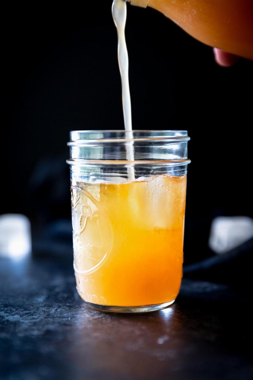 Mason jar with sun tea and added guava