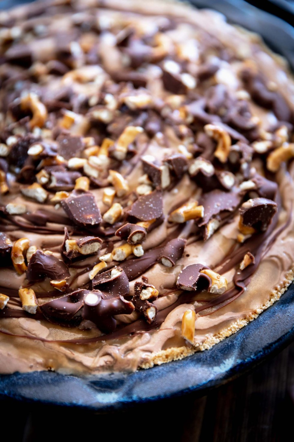Close up of peanut butter pie with chocolate and caramel swirls