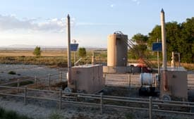 Tanks hold natural gas condensate and mark the spot of producing gas wells in the Pavillion field, in Fremont County, Wyo., in the heart of the Wind River Indian Reservation. The Environmental Protection Agency has found chemicals that are used in gas drilling in water wells near this site. (Abrahm Lustgarten/ProPublica)