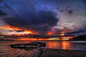 The sun casts a dramatic glow over Yellowstone Lake. (photo ©Leon Jenson —click to enlarge)