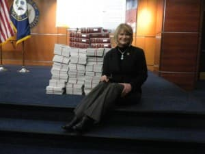 Cynthia Lummis with Regulation papers