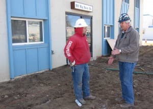 71 Construction president Steve Loftin, right, visits with his employee Dave Miller at a job site in Casper. Loftin said he's frustrated with the failure of legislators and Congress to address the rising cost of health care so he got involved with the Wyoming Business Coalition on Health to try to find solutions in Wyoming. (Dustin Bleizeffer/WyoFile -  click to enlarge)