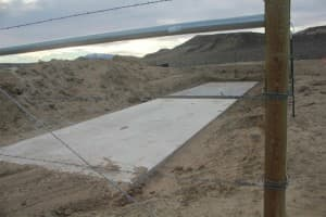 Two concrete pads, poured in late 2010, are the only physical evidence yet of DKRW's project which was first announced in 2004.
