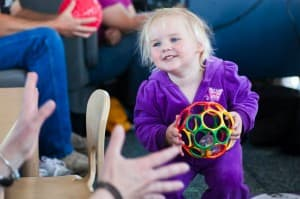 2-year-old Devyn Fillin is focused on Michelle Carr, who works to catch the child's every verbal and non-verbal cue. The keys to learning are responding to the child, and repeating and reinforcing the lesson.