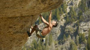 """BJ TIlden climbs on The film """"Wind and Rattlesnakes; the Birth of a Western Climbing Town."""" (Photo from the film """"Wind and Rattlesnakes; the Birth of a Western Climbing Town"""" — click to enlarge)"""