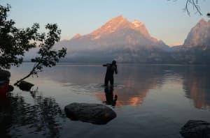 "David Gonzales enters Jenny Lake after biking from Jackson last July.  Gonzales created the ""Teton Triathlon"" to challenge himself. (Photo Courtesy John Douglass)"