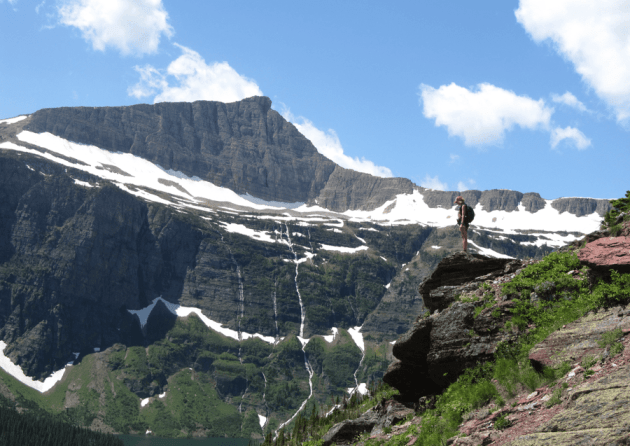 Kelly Bouma takes in the view on a hike in Glacier National Park. (WyoFile/Kelsey Dayton — click to enlarge)