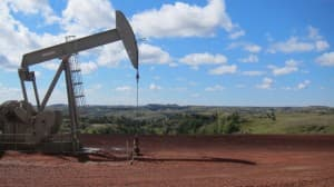 A new oil pumpjack rocks several miles from Theodore Roosevelt's Elkhorn Ranch in North Dakota. (Dustin Bleizeffer/WyoFile — click to enlarge)