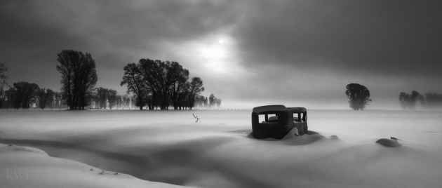 An old car sits under a blanket of snow on the old Porter Estate along High School Road in Jackson. (Kathy Tompkins — Click to Enlarge)