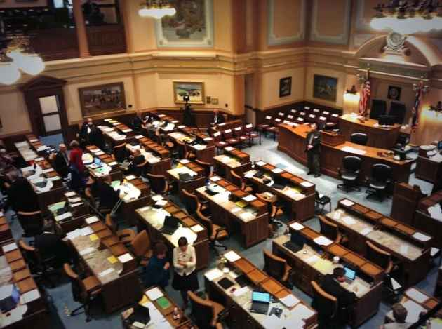 """The Wyoming House Floor at the opening of hte 2014 budget Session. House Minority Floor Leader Mary Throne (D-Cheyenne), at lower center in tan jacket, has asked for a public discussion of Wyoming's savings policy, and the """"rainy day"""" account in particular. (WyoFile/Gregory Nickerson — click to enlarge)"""