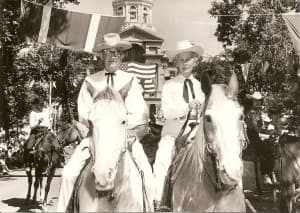 """Gov. Jack Gage and wife """"Buddy"""" ride in the Cheyenne Frontier Days parade in 1962. (Wikimedia Commons — click to enlarge)"""