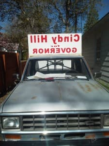 A truck advertises a sign for Cindy Hill in reverse so it reads correctly in the rear view mirror. (Facebook — click to enlarge)