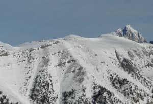 Current bighorn sheep winter range in the Tetons is characterized by high elevation, windswept ridgelines and slopes. Mt. Hunt (10,783 ft.) and Prospectors Mountain (11,241 ft.), pictured here, are used extensively by bighorn sheep during winter, and are within seasonal closures in Grand Teton National Park. (Photo by Alyson Courtemanch — click to enlarge)