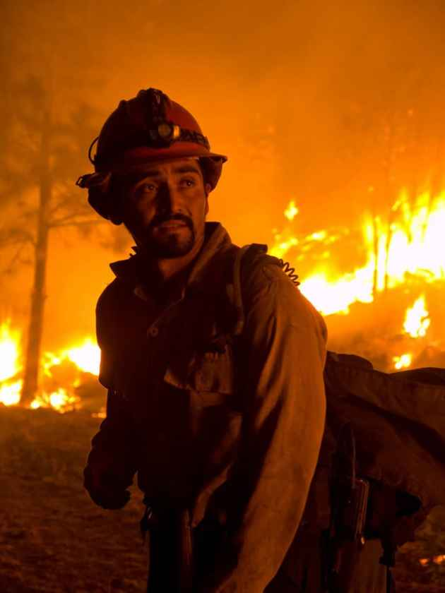 A firefighter on the line at the Las Conchas Fire in New Mexico in 2011. Officials disagree with a group of retired firefighters that firefighter safety is not always given top priority. (Kari Greer/USFS click to enlarge)