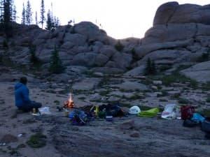 Laurel enjoys the campfire as dusk settles around our kitchen on the rock slabs. (Emilene Ostlind - click to enlarge)