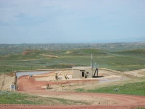 Dozens of operators drilled more than 25,000 coal-bed methane gas wells in the Powder River Basin, requiring water storage, pipelines, compressors and other related facilities.  Thousands of wells and related facilities have been orphaned, leaving a cleanup liability in the tens of millions of dollars. (Dustin Bleizeffer/WyoFile).