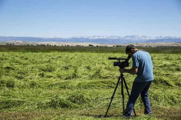 DIrector of photography Peter Mallamo films haying at Charles and Deanne Price's ranch near Pinedale, WY. (Cr. Louise Johns - click to enlarge)
