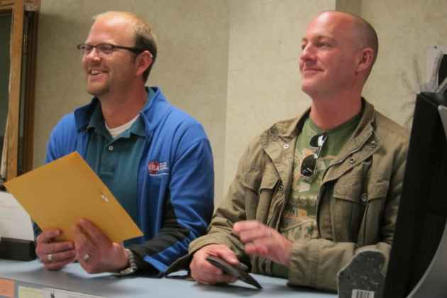 Dirk Andrews (left) and Travis Gray were the first same-sex couple to obtain a marriage license in Casper, just after 10 a.m. on Tuesday after Wyoming's ban on same-sex marriage was lifted. (Dustin Bleizeffer/WyoFile — click to enlarge)