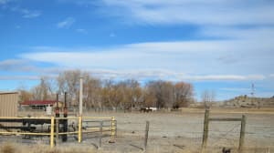 Natural gas facilities intermingle with ranching and farming northeast of Pavillion, where groundwater contamination has drawn focus on hydraulic fracturing. (Dustin Bleizeffer/WyoFile — click to enlarge)