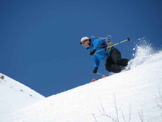 Patrick Mahoney skis on the southeast face of Cream Puff Peak in the Gros Ventre Mountains. A new guide to backcountry skiing near Jackson offers hundreds of photographs. (photo by Thomas Turiano — click to enlarge)