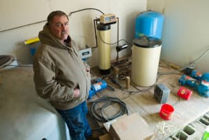 Jeffrey Locker has installed a Rube-Goldgberg series of pumps and filters in an attempt to purify water from his well in Pavillion. (Angus M. Thuermer Jr./WyoFile — click to enlarge)