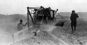 A trencher digs a ditch for a pipeline, perhaps in the 1920s, in this undated photo. (Casper College Western History Center. - click to enlarge)