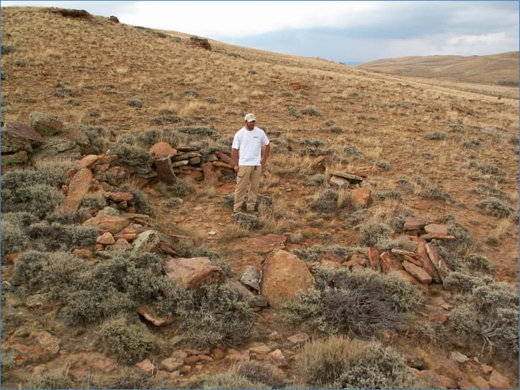 Bryon Schroeder stands in a structure first excavated 45 years ago in the Shirley Basin. (courtesy Bryon Schroeder)