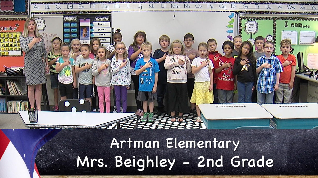 Mrs. Beighley's Artman Elementary second grade class reciting the Pledge of Allegiance._55441