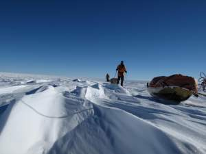 Larsen's crew skiing across Antarctica. Courtesy: Eric Larsen, Save the Poles..
