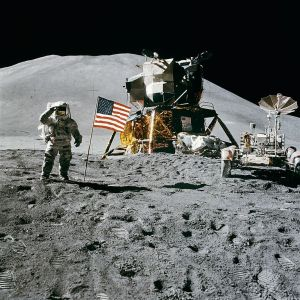 Irwin, the American Flag, the Lunar Rover, and the LM Falcon in the rear, at Hadley Rille