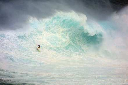 Extreme Big wave surfing at Jaws Maui